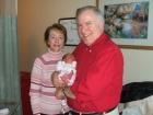 Grandma and Grandpa. Paul's parents holding Aryn.