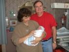 Nana and Pop-pop. Jennifer's parents holding Aryn.