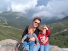 Top of the World. Jennifer, Ainsley, and Aidyn sitting at the Alpine visitors center in RMNP.  This is the highest road in North America.  We're even above the clouds.